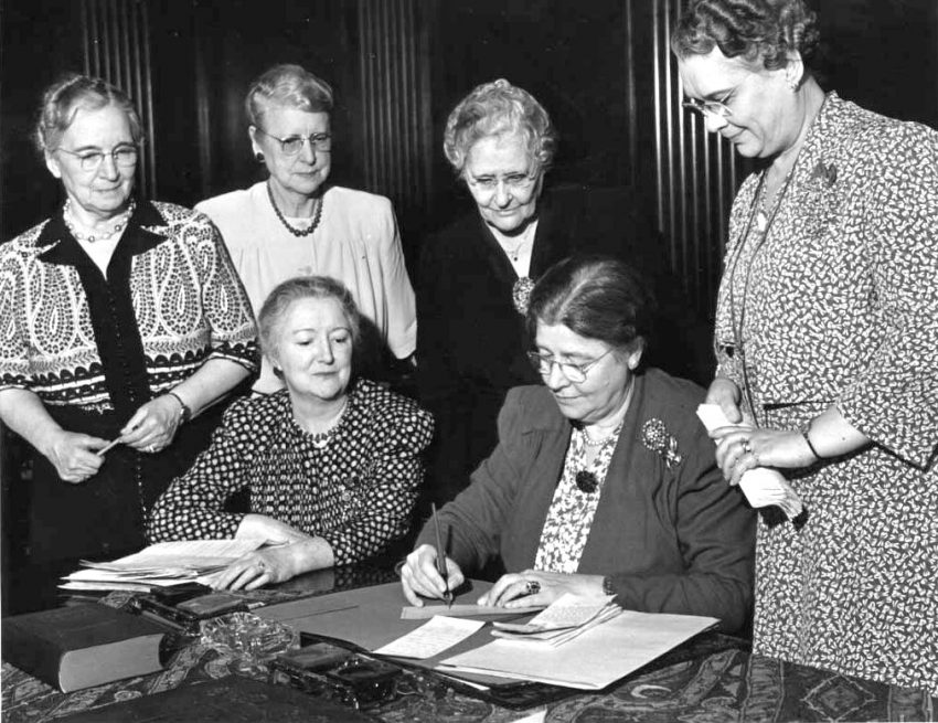 Royal Neighbors Founders signing a check